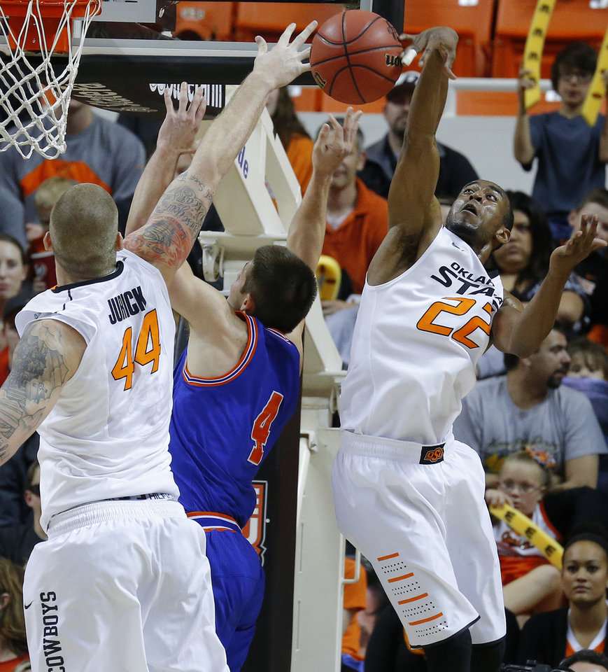 Oklahoma State's Markel Brown (22) blocks the shot of Texas-Arlington's Drew Charles (4) beside Philip Jurick (44)during a college basketball game between Oklahoma State University and UT Arlington at Gallagher-Iba Arena in Stillwater, Okla., Wednesday, Dec. 19, 2012. Photo by Bryan Terry, The Oklahoman