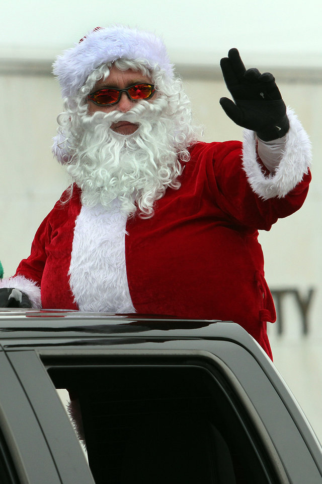 Photo - Santa Clause waves to the crowd during the 47th annual Czech Festival parade Saturday in Yukon. PHOTO BY HUGH SCOTT FOR THE OKLAHOMAN