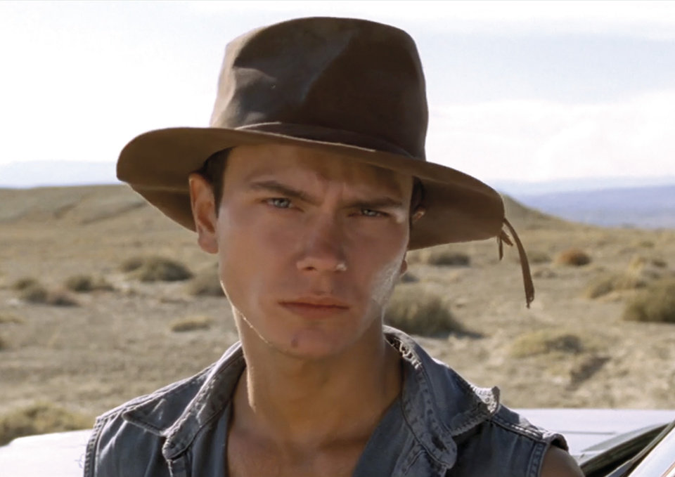 "In this undated photo provided by the Miami International Film Festival, actor River Phoenix is shown while filming the movie ""Dark Blood."" After his death, there was talk of finding another actor to replace Phoenix or using special effects to finish the film which was about 80 percent complete, but director George Sluizer ultimately passed on those options and the film footage sat untouched in a vault for years. Sluizer was diagnosed with an arrhythmia in 2007, but the director made a miraculous recovery and felt compelled to finish ""Dark Blood"" before it was too late. The film had its U.S. premiere at the Miami International Film Festival on Wednesday, March 6, 2013 in Miami. (AP Photo/Miami International Film Festival)"
