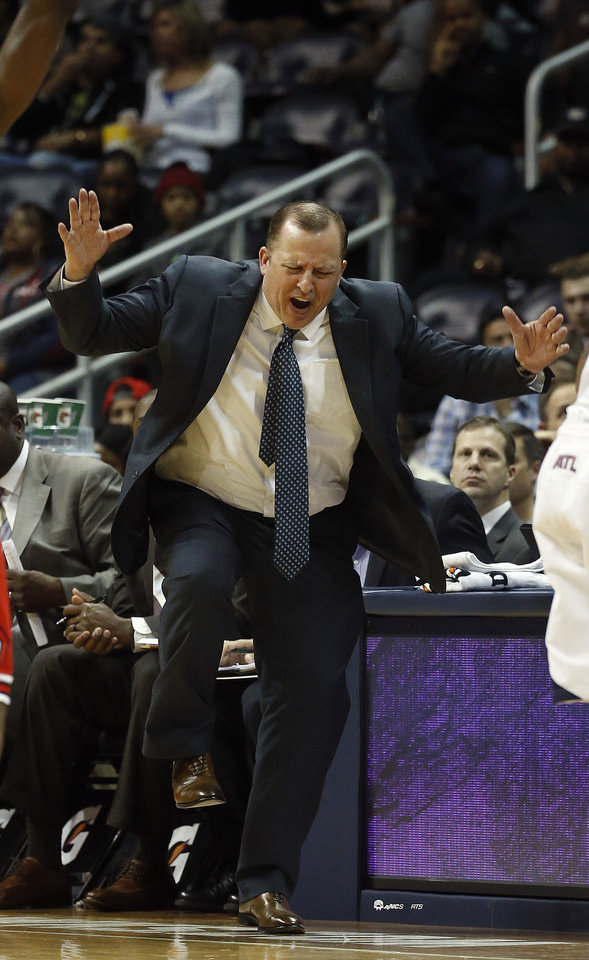 Photo - Chicago Bulls head coach Tom Thibodeau reacts after a Bulls' foul in the second half of an NBA basketball game against the Atlanta Hawks, Tuesday, Feb. 25, 2014, in Atlanta. Chicago won 107-103. (AP Photo/John Bazemore)