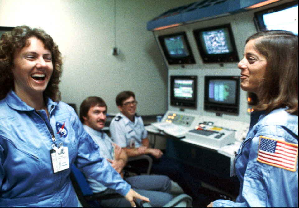 Photo - CHALLENGER SPACE SHUTTLE EXPLOSION / DEATHS:      FILE - In this 1986 file photo, Christa McAuliffe, left, and Barbara Morgan, right, laugh during training.  A whole generation _ including McAuliffe's own students _ has grown up since McAuliffe and six other astronauts perished on live TV on Jan. 28, 1986, a quarter century ago on Friday, Jan. 28, 2011. Now the former schoolchildren who loved her are making sure that people who weren't even born then know about McAuliffe and her dream of going into space. (AP Photo/NASA, File) ORG XMIT: NY123