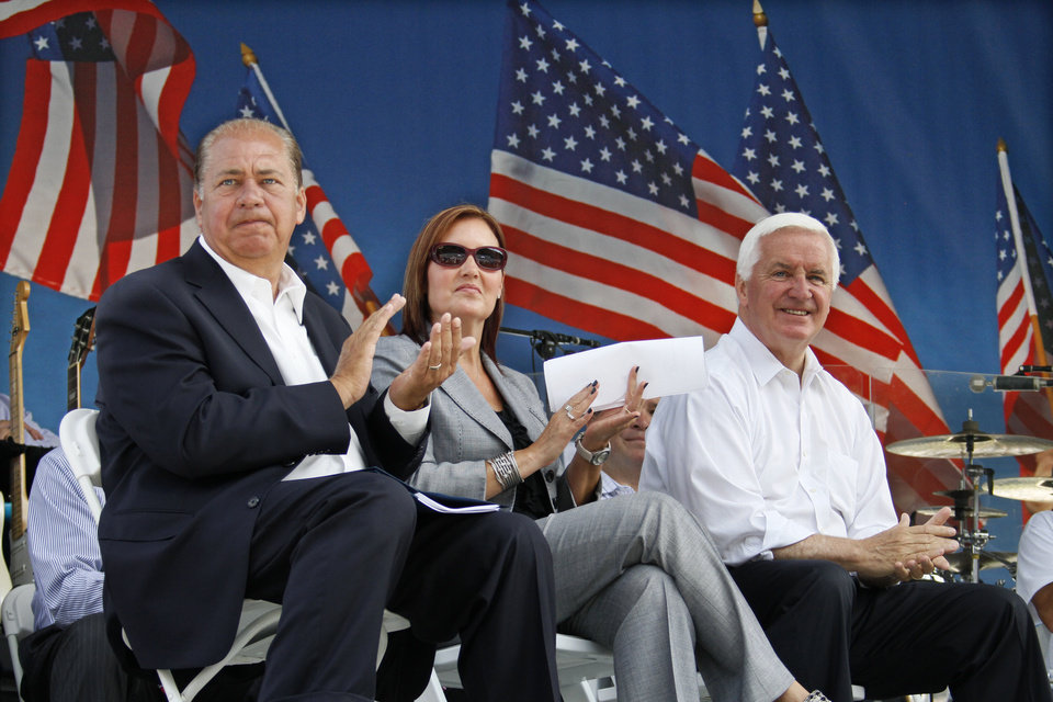 Photo - Pennsylvania Governor Tom Corbett, right, sits with West Virginia Governor Earl Ray Tomblin, left, and Ohio Lt. Governor Mary Taylor while waiting to address a rally to support American energy and jobs in the coal and related industries at Highmark Stadium in downtown Pittsburgh, Wednesday, July 30, 2014. The rally is being held the day before the Environmental Protection Agency conducts public hearings on its new emissions regulations for existing coal fired power plants. (AP Photo/Gene J. Puskar)