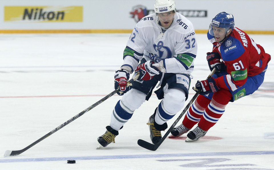 Photo -   Erik Christensen, left, from Lev Praha challenges Alexander Ovechkin from Dynamo Moscow during their KHL ice hockey match in Prague, Czech Republic, Tuesday, Oct. 9, 2012. Ovechkin is among those NHL players who were signed by European clubs because of the NHL lockout. (AP Photo/Petr David Josek)