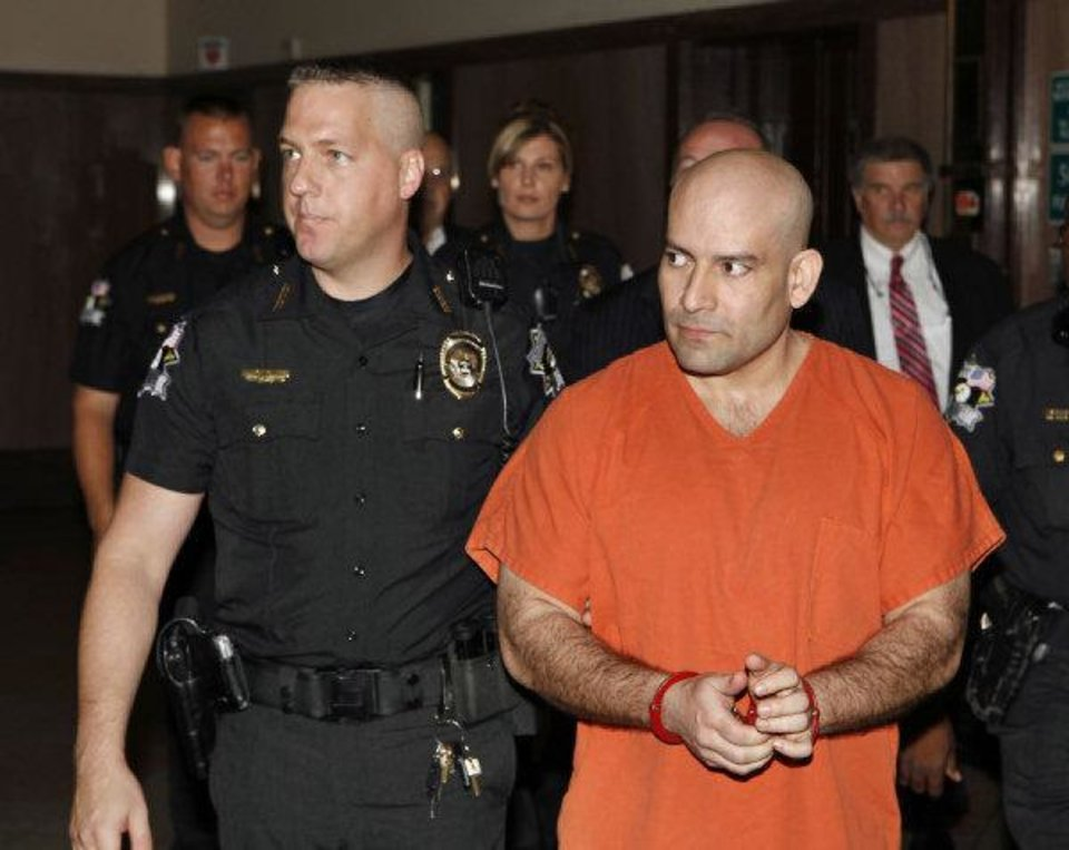 Maurice Martinez, right,  is escorted by Oklahoma County Deputy Sheriff Johnny Singley to his preliminary hearing.  <strong>PAUL B. SOUTHERLAND - PAUL B. SOUTHERLAND</strong>