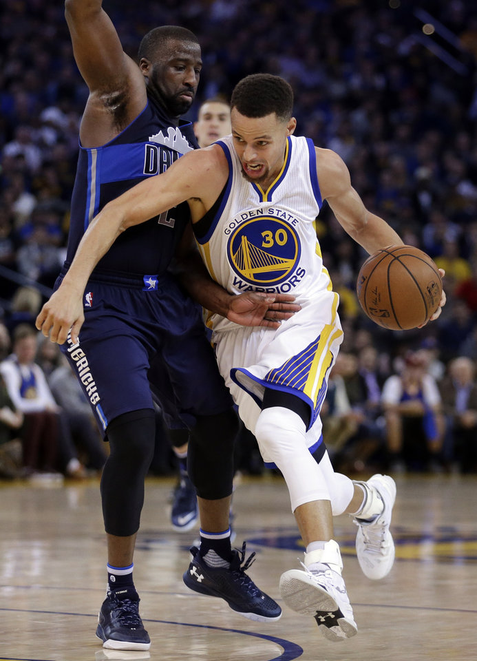 Photo - Stephen Curry, right, has helped make Golden State the NBA's elite team. (AP Photo)