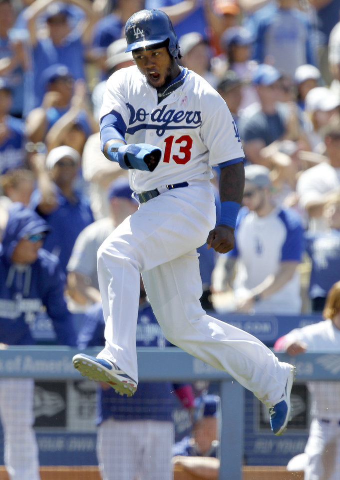 Photo - Los Angeles Dodgers' Hanley Ramirez (13) reacts running to score at home without a throw on a single to center by the Dodgers' Adrian Gonzalez in the sixth inning of a baseball game against the San Francisco Giants on Sunday, May 11, 2014, in Los Angeles. (AP Photo/Alex Gallardo)