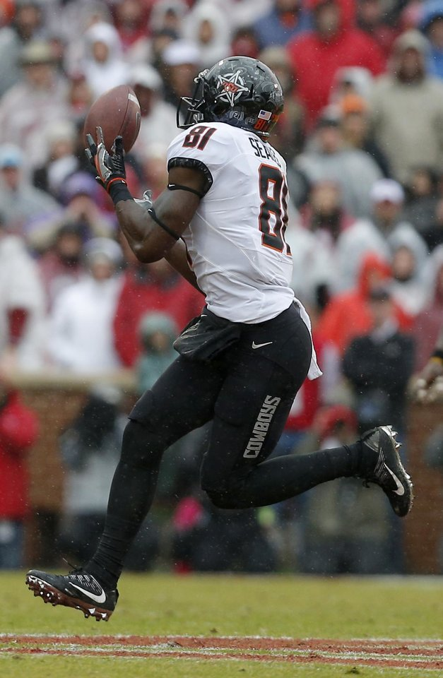 Photo - Oklahoma State's Jhajuan Seales (81) makes a catch in the third quarter during the Bedlam college football game between the Oklahoma Sooners (OU) and the Oklahoma State Cowboys (OSU) at Gaylord Family - Oklahoma Memorial Stadium in Norman, Okla., Saturday, Dec. 3, 2016. OU won 38-20. Photo by Sarah Phipps, The Oklahoman