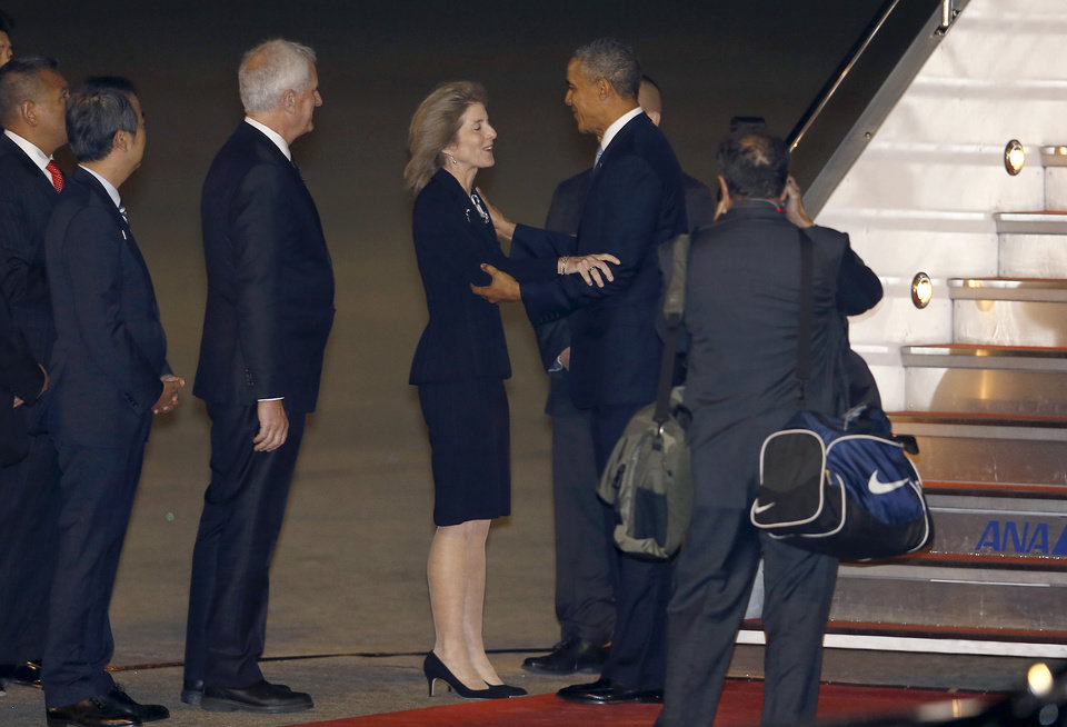 Photo - U.S. President Barack Obama is welcomed by U.S. Ambassador to Japan Caroline Kennedy upon his arrival at Haneda International Airport in Tokyo, Wednesday, April 23, 2014. Obama is in Japan for a three-day state visit. (AP Photo/Shizuo Kambayashi)