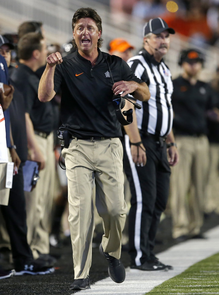 Photo - Oklahoma State coach Mike Gundy argues a call in the second quarter during a college football game between Oklahoma State (OSU) and South Alabama at Boone Pickens Stadium in Stillwater, Okla., Saturday, Sept. 8, 2018. Photo by Sarah Phipps, The Oklahoman