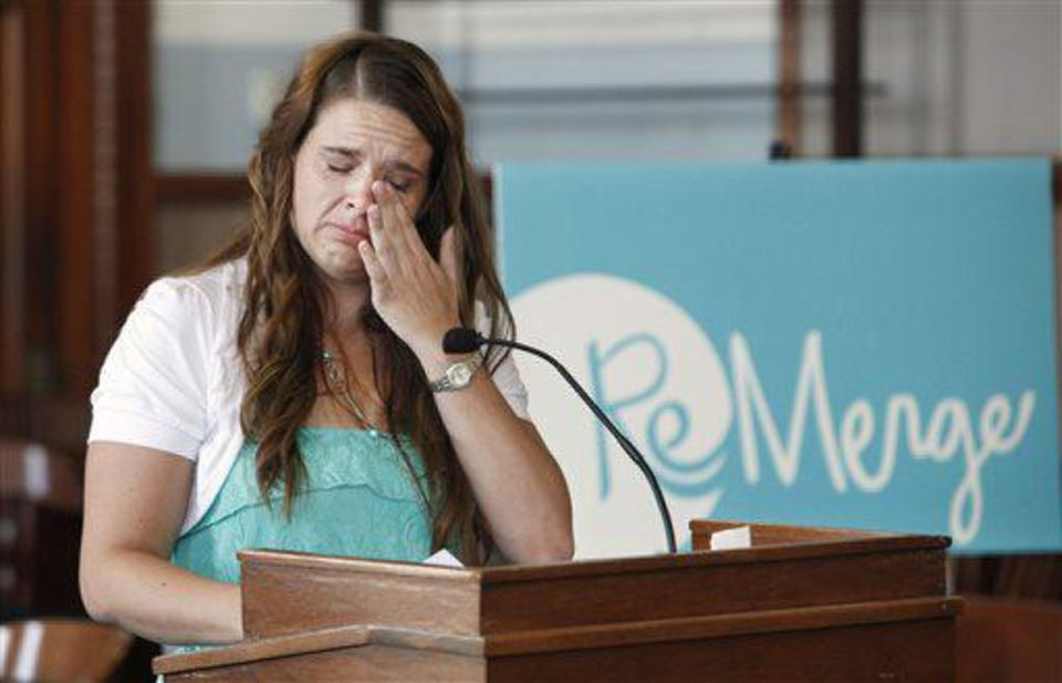 Photo - Chrystal Kinsey, Moore,  wipes her eyes while delivering her speech during the ReMerge graduation ceremonies at the Oklahoma County Courthouse in Oklahoma City on Tuesday. The Oklahoman, Paul B. Southerland  PAUL B. SOUTHERLAND