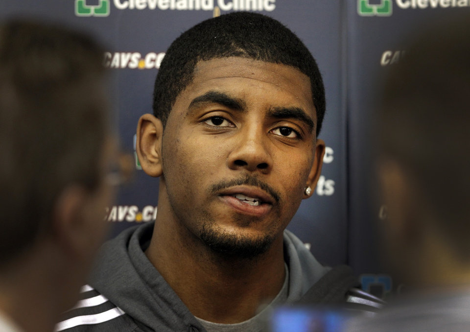 Photo -   With the team's season ended, Cleveland Cavaliers Kyrie Irving talks to the media at the team's practice facility in Independence, Ohio, on Friday, April 27, 2012. (AP Photo/Amy Sancetta)