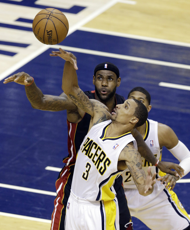Indiana Pacers' George Hill (3) is defended by Miami Heat's LeBron James during the second half of Game 3 of the NBA Eastern Conference basketball finals in Indianapolis, Sunday, May 26, 2013. (AP Photo/Michael Conroy)