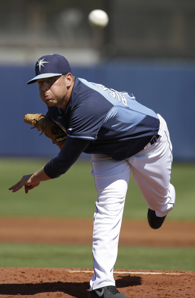 Photo - Tampa Bay Rays pitcher C.J. Riefenhauser delivers a warm-up throw in the second inning an exhibition baseball game against the Philadelphia Phillies, Monday, March 3, 2014, in Port Charlotte, Fla. (AP Photo/Steven Senne)