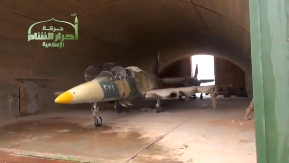 Photo - This image taken from video obtained from Ugarit News, which has been authenticated based on its contents and other AP reporting, shows a Syrian fighter jet in a hangar after rebels captured Jarrah airfield in Aleppo province, Tuesday, Feb. 12, 2013. Rebels captured a military air base in northern Syria on Tuesday, their second major strategic victory in as many days, activists said.(AP Photo/Ugarit News via AP video)