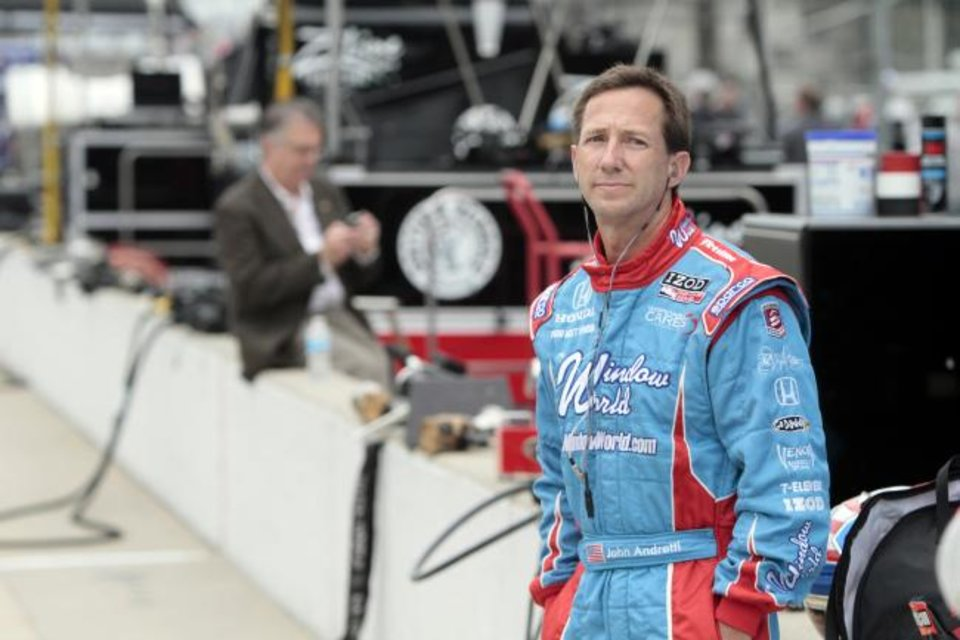 Photo -  In this May 19, 2010, photo, John Andretti watches practice for the Indianapolis 500 auto race. Andretti, a member of one of racing's most families, died Thursday following a battle with colon cancer. He was 56. [AP Photo/AJ Mast]