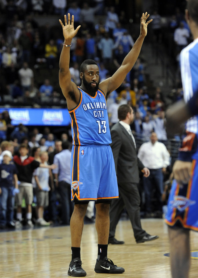 Photo - Oklahoma City Thunder guard James Harden (13) celebrates during the second half of game 3 of a first-round NBA basketball playoff series against the Denver Nuggets Saturday, April 23, 2011, in Denver. Oklahoma City beat Denver 97-94 to take a 3-0 series lead. (AP Photo/Jack Dempsey)