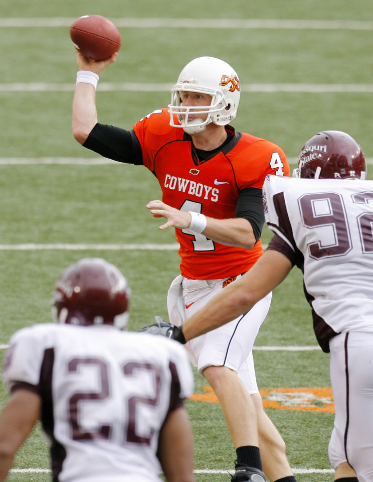 Photo - Brandon Weeden tosses a pass oposite the rush of Chris Brehmer (92) as Kolby Hurt drops back at the Oklahoma State University (OSU) football game against Missouri State University (MSU) Saturday Sept. 13, 2008 at Boone Pickens Stadium in Stillwater, Okla. BY MATT STRASEN, THE OKLAHOMAN.