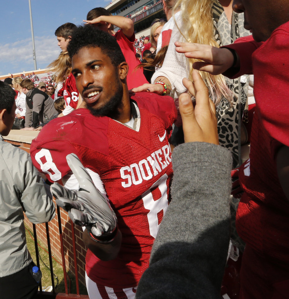 Photo - Oklahoma Sooner's Jalen Saunders (8) greets fans after the college football game between the University of Oklahoma Sooners (OU) and the Iowa State University Cyclones (ISU) at Gaylord Family-Oklahoma Memorial Stadium in Norman, Okla. on Saturday, Nov. 16, 2013. Photo by Steve Sisney, The Oklahoman