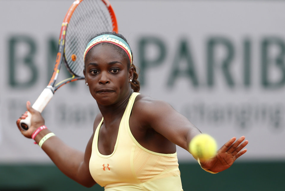 Photo - Sloane Stephens of the U.S.  returns the ball during the fourth round match of the French Open tennis tournament against Romania's Simona Halep at the Roland Garros stadium, in Paris, France, Monday, June 2, 2014. (AP Photo/Darko Vojinovic)