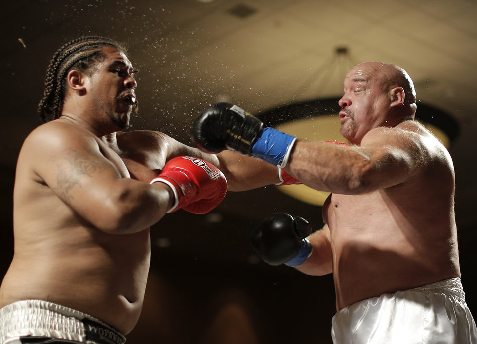 Ron Aubrey (right), of Oklahoma City, fights Alonzo Toney, of Inglewood, Calif., at the Cox Convention Center in Oklahoma City, Thursday, Sept. 20, 2012.  Photo by Garett Fisbeck, The Oklahoman