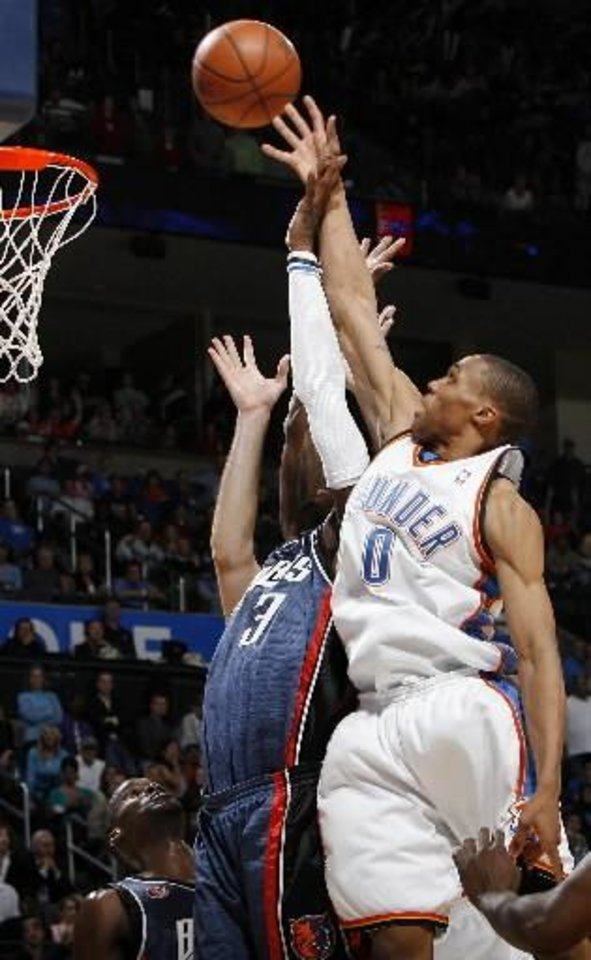 Oklahoma City's  Russell  Westbrook (0) tips in a shot over Gerald Wallace (3) of Charlotte in the second half of the NBA basketball game between the Charlotte Bobcats and the Oklahoma City Thunder at the Ford Center in Oklahoma City, Friday, April 10, 2009. Oklahoma City won, 84-81. Photo by Nate Billings