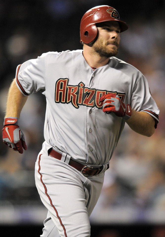 Photo -   Arizona Diamondbacks' Jason Kubel (13) rounds the bases after hitting a three-run home run off Colorado Rockies starting pitcher Tyler Chatwood during the fourth inning of a baseball game, Monday, Sept. 24, 2012, in Denver. (AP Photo/Jack Dempsey)