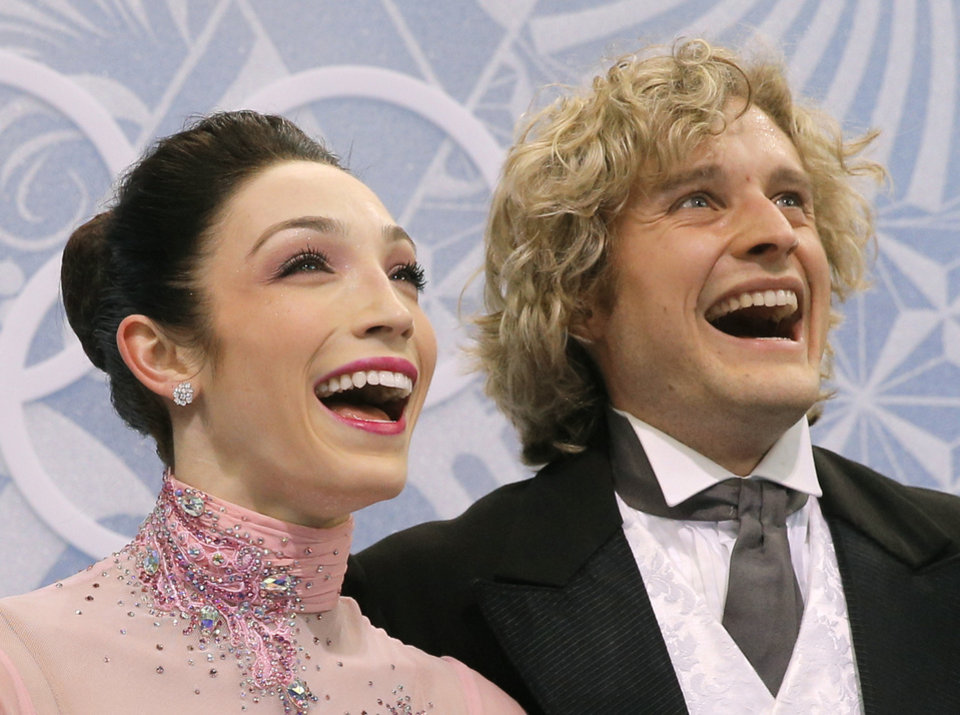 Photo - Meryl Davis and Charlie White of the United States smile as they wait in the results area after competing in the ice dance short dance figure skating competition at the Iceberg Skating Palace during the 2014 Winter Olympics, Sunday, Feb. 16, 2014, in Sochi, Russia. (AP Photo/Vadim Ghirda)