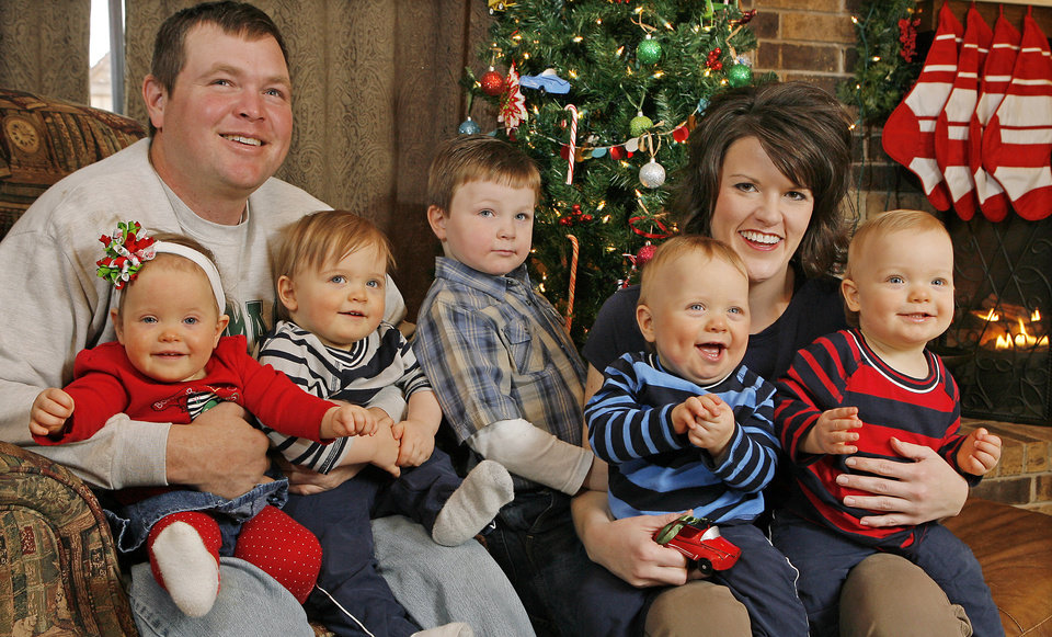 Photo - Rick and Jennifer Payne pose with Claire and Preston (on Rick's lap), Griffin and Carson (on Jennifer's lap), and oldest son Parker, middle, in 2008.  Photo by David McDaniel, The Oklahoman Archives
