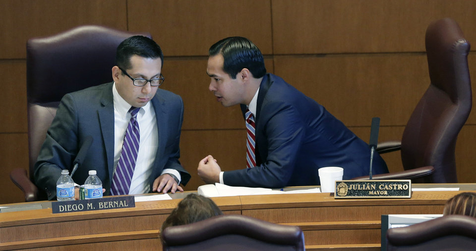 Photo - San Antonio Mayor Julian Castro, right, talks with councilman Diego Bernal, sponsor of a proposed non-discrimination ordinance, Thursday, Sept. 5, 2013, in San Antonio. The San Antonio city council passed the ordinance which will in part prohibit discrimination based on sexual orientation and gender identity. (AP Photo/Eric Gay)