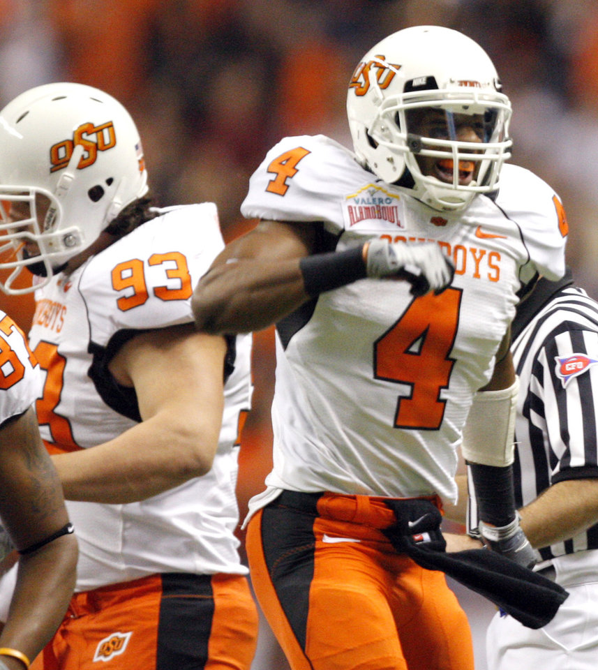 Photo - Oklahoma State's Justin Gilbert (4) celebrates a fumble recovery during the Valero Alamo Bowl college football game between the Oklahoma State University Cowboys (OSU) and the University of Arizona Wildcats at the Alamodome in San Antonio, Texas, Wednesday, December 29, 2010. Photo by Sarah Phipps, The Oklahoman