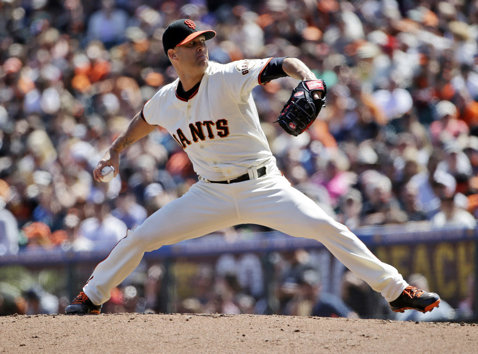 Photo - San Francisco Giants starting pitcher Tim Hudson throws to the Colorado Rockies during the fifth inning of a baseball game on Sunday, April 13, 2014, in San Francisco. (AP Photo/Marcio Jose Sanchez)