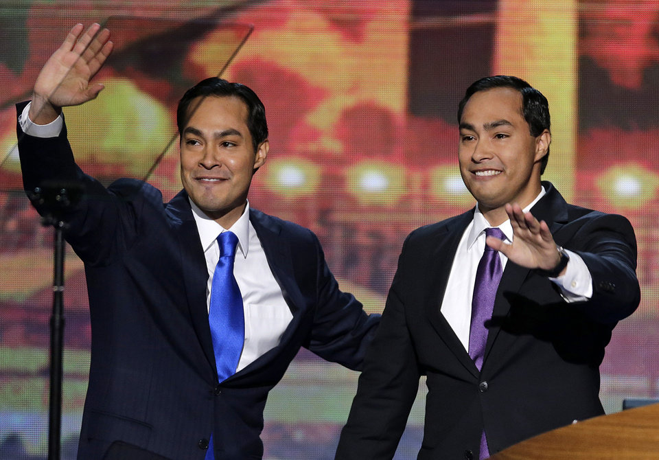 Photo - San Antonio Mayor Julian Castro and his brother Joaquin Castro, right, wave to the Democratic National Convention in Charlotte, N.C., on Tuesday, Sept. 4, 2012. (AP Photo/J. Scott Applewhite)  ORG XMIT: DNC181