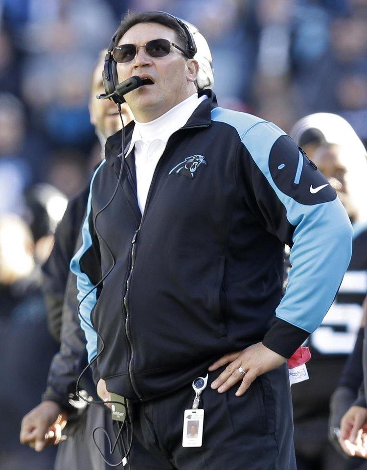 Photo - Carolina Panthers head coach Ron Rivera watches play against the San Francisco 49ers during the first half of a divisional playoff NFL football game, Sunday, Jan. 12, 2014, in Charlotte, N.C. (AP Photo/Gerry Broome)