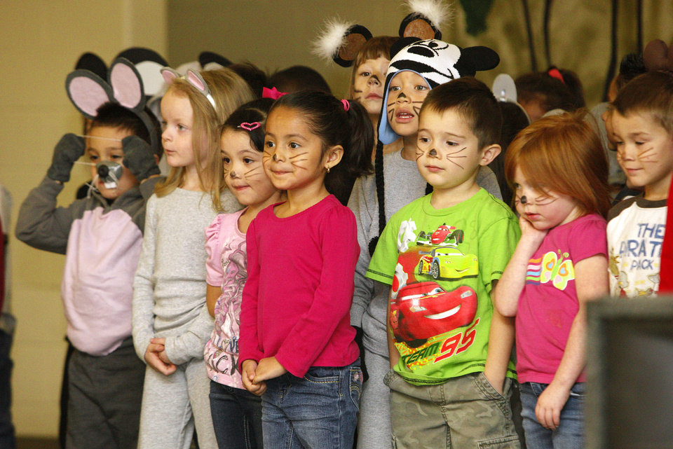 "Photo - Prekindergarten students perform as mice in the play ""Cinderella"" at John Glenn Elementary School in Oklahoma City. The play was directed by Karen Bentley, who works as music teacher in the Western Heights Public Schools district.  Photos by Paul B. Southerland, The Oklahoman"
