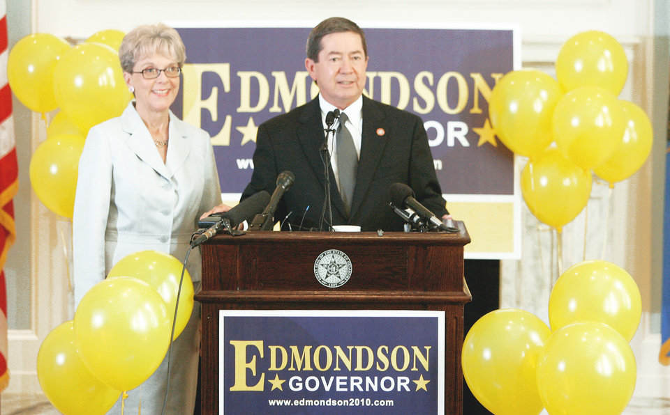 Photo - Drew Edmondson, with his wife, Linda, announces Wednesday at the state Capitol he is running for governor.  PHOTO BY STEVE GOOCH, THE OKLAHOMAN