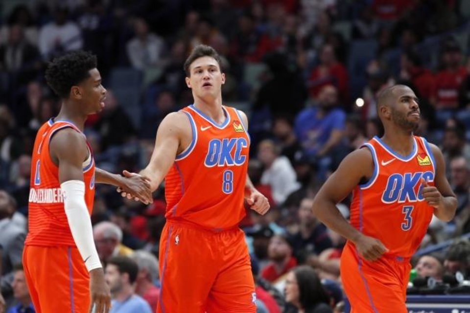 Photo -  Oklahoma City Thunder forward Danilo Gallinari, center, celebrates a 3-point basket with guards Shai Gilgeous-Alexander, left, and Chris Paul during Sunday's 107-104 win over New Orleans. Gallinari led Oklahoma City with 23 points. [AP Photo/Gerald Herbert]