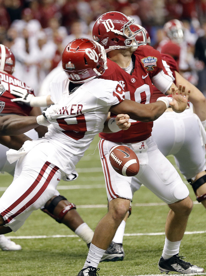 Photo - Oklahoma's Eric Striker (19) forces a fumble on Alabama's AJ McCarron (10) during the NCAA football BCS Sugar Bowl game between the University of Oklahoma Sooners (OU) and the University of Alabama Crimson Tide (UA) at the Superdome in New Orleans, La., Thursday, Jan. 2, 2014.  .Photo by Chris Landsberger, The Oklahoman