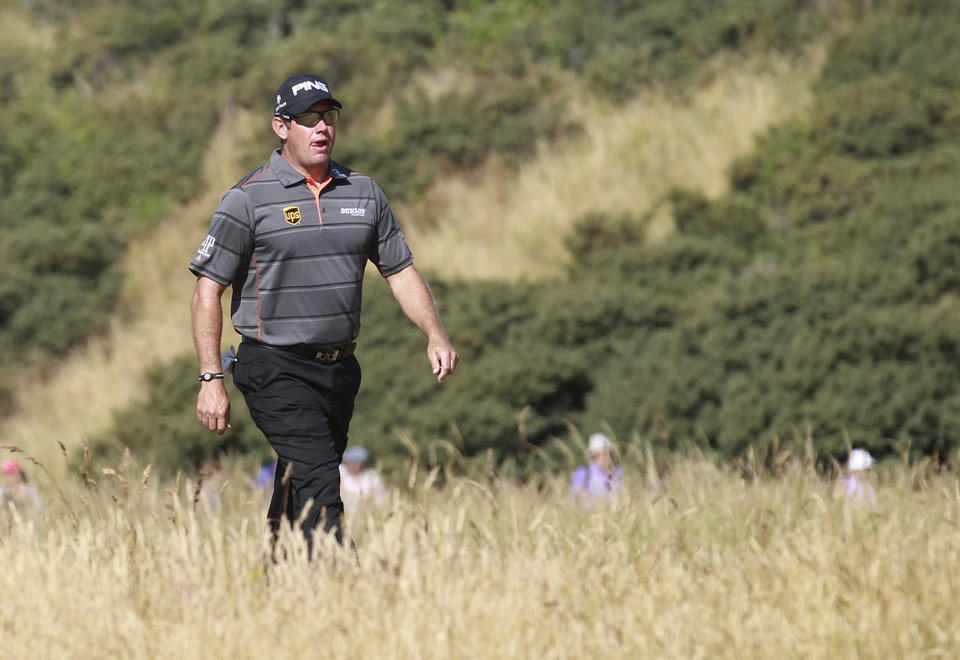 Photo - Lee Westwood of England walks along the 4th fairway during the second round of the British Open Golf Championship at Muirfield, Scotland, Friday July 19, 2013. (AP Photo/Peter Morrison)