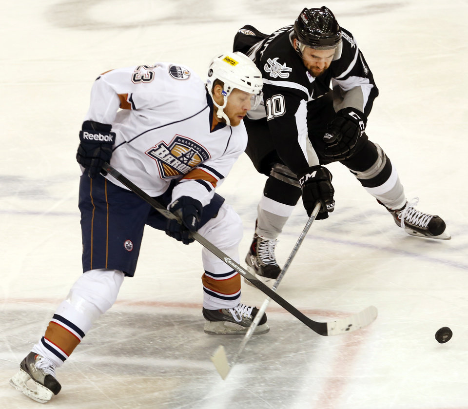 Barons'  Linus Omark and San Antonio's Jon Matsumoto battle for the puck during their game at the Cox Convention Center in Oklahoma City, Tuesday November 12, 2013. Photo By Steve Gooch, The Oklahoman