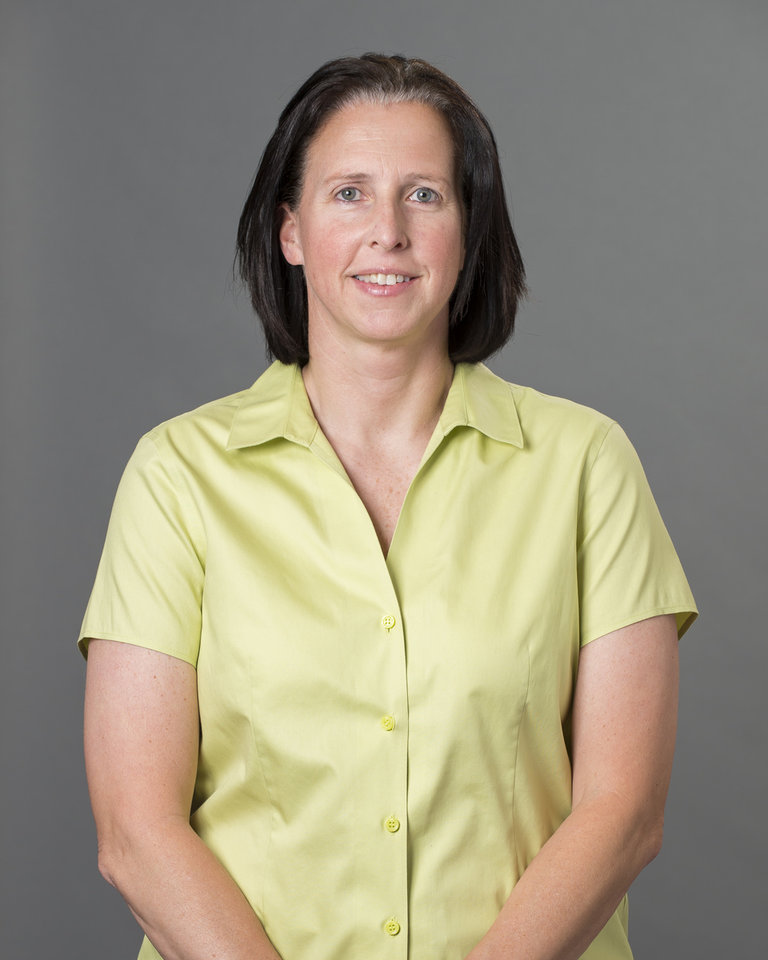 Photo - This 2013 photo provided by the University of Richmond shows associate head coach Ginny Doyle. Doyle and director of basketball operations Natalie Lewis were two of the three people aboard a hot air balloon that drifted into a power line, burst into flames and crashed on Friday, May 9, 2014, in Virginia. Investigators say their remains were found about a mile apart in dense woods. (AP Photo/University of Richmond, Frank Strauss)