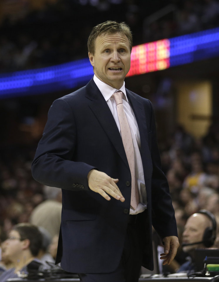 Photo - Oklahoma City Thunder head coach Scott Brooks reacts during the fourth quarter of an NBA basketball game against the Cleveland Cavaliers, Saturday, Feb. 2, 2013, in Cleveland. The Cavaliers won 115-110. (AP Photo/Tony Dejak) ORG XMIT: OHTD111