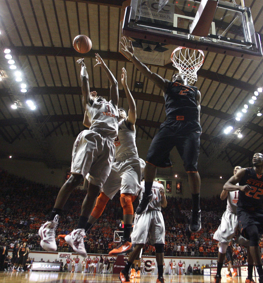 Virginia Tech guard Robert Brown (1) goes up for a rebound against Oklahoma State's Le'Bryan Nash (2) during the second half of an NCAA college basketball game in Blacksburg, Va., Saturday, Dec. 1, 2012. (AP Photo/Daniel Lin) ORG XMIT: VADL111