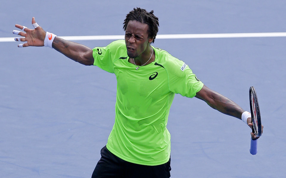 Photo - Gael Monfils, of France, reacts after defeating Grigor Dimitrov, of Bulgaria, during the fourth round of the 2014 U.S. Open tennis tournament, Tuesday, Sept. 2, 2014, in New York. (AP Photo/Darron Cummings)