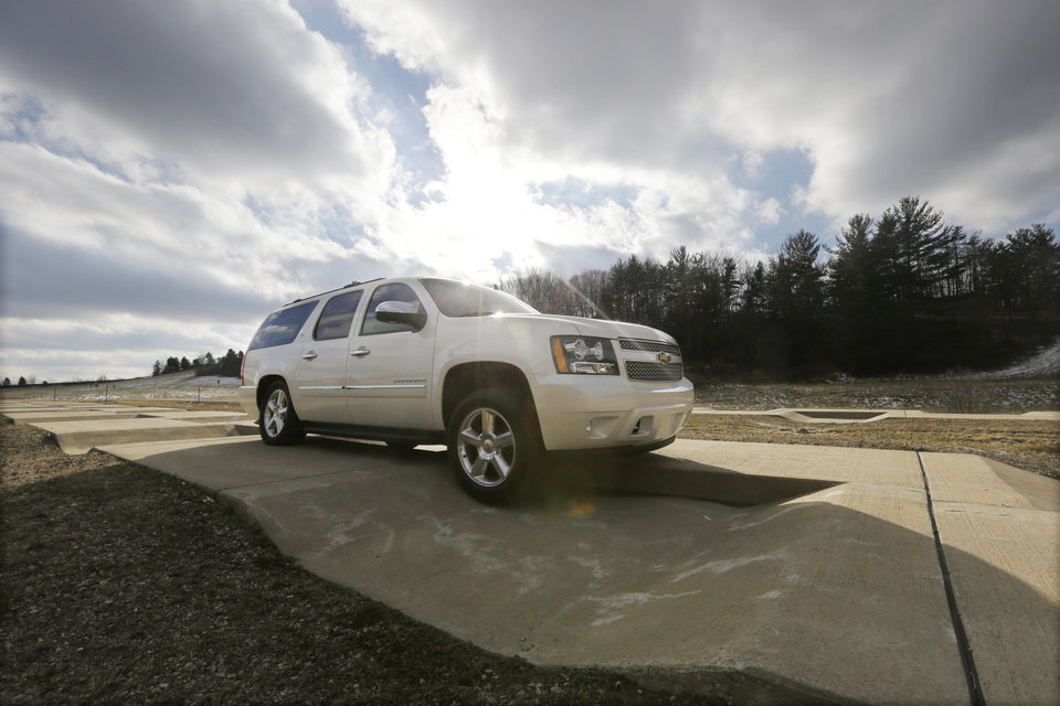 In a Jan. 17, 2013 photo, a Chevrolet Suburban is driven through the uneven terrain course at the General Motors Milford Proving Grounds in Milford, Mich. It\'s in this northwest Detroit suburb that GM has its testing facility, which, according to GM consumer affairs chief James Bell, exists for the purpose of beating