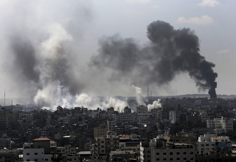 Photo - Smoke from Israeli strikes rise over Gaza City, in the northern Gaza Strip, Sunday, July 27, 2014. Israel resumed its Gaza offensive on Sunday, calling off a unilateral extension of a humanitarian cease-fire after Palestinian militants fired several rockets at southern Israel. The rocket fire began late Saturday after Gaza's Hamas rulers, who have demanded the lifting of an Israeli and Egyptian blockade on the territory and the release of prisoners, refused to extend the truce. (AP Photo/Adel Hana)