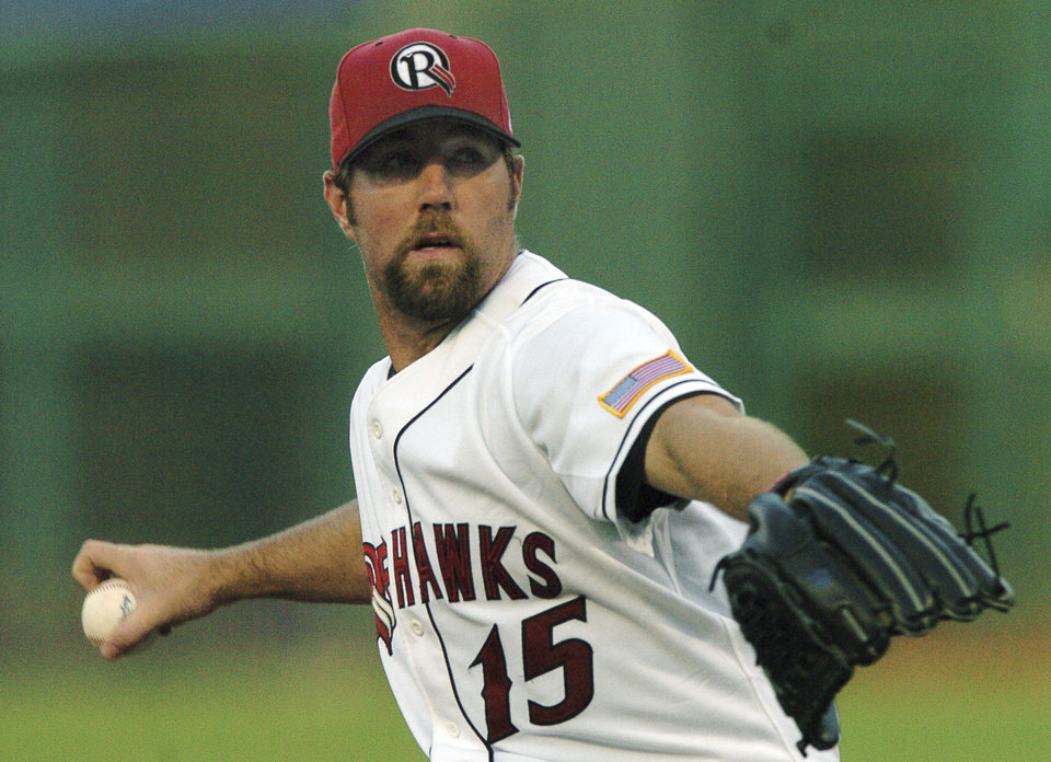OKLAHOMA CITY, OKLA. SUNDAY, JULY 24, 2005:  MINOR LEAGUE BASEBALL PLAYER/ PITCH: Oklahoma RedHawks pitcher R.A. Dickey throws a knuckleball against Iowa.  Staff photo by Michael Downes.
