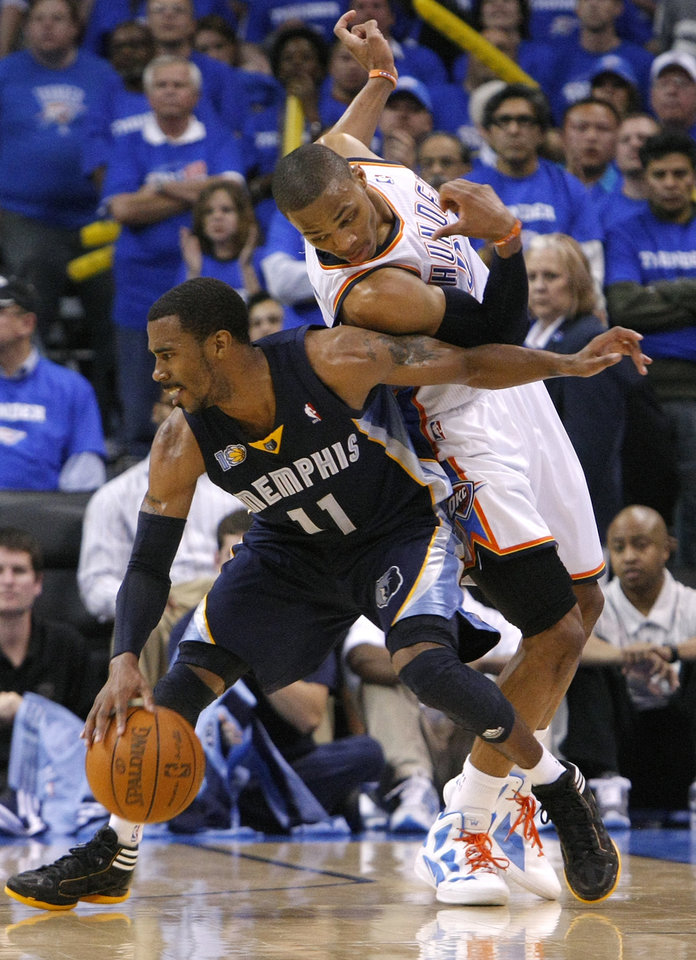 Mike Conley (11) of Memphis tries to get past Oklahoma City's Russell Westbrook (0) during game two of the Western Conference semifinals between the Memphis Grizzlies and the Oklahoma City Thunder in the NBA basketball playoffs at Oklahoma City Arena in Oklahoma City, Tuesday, May 3, 2011. Photo by Chris Landsberger, The Oklahoman