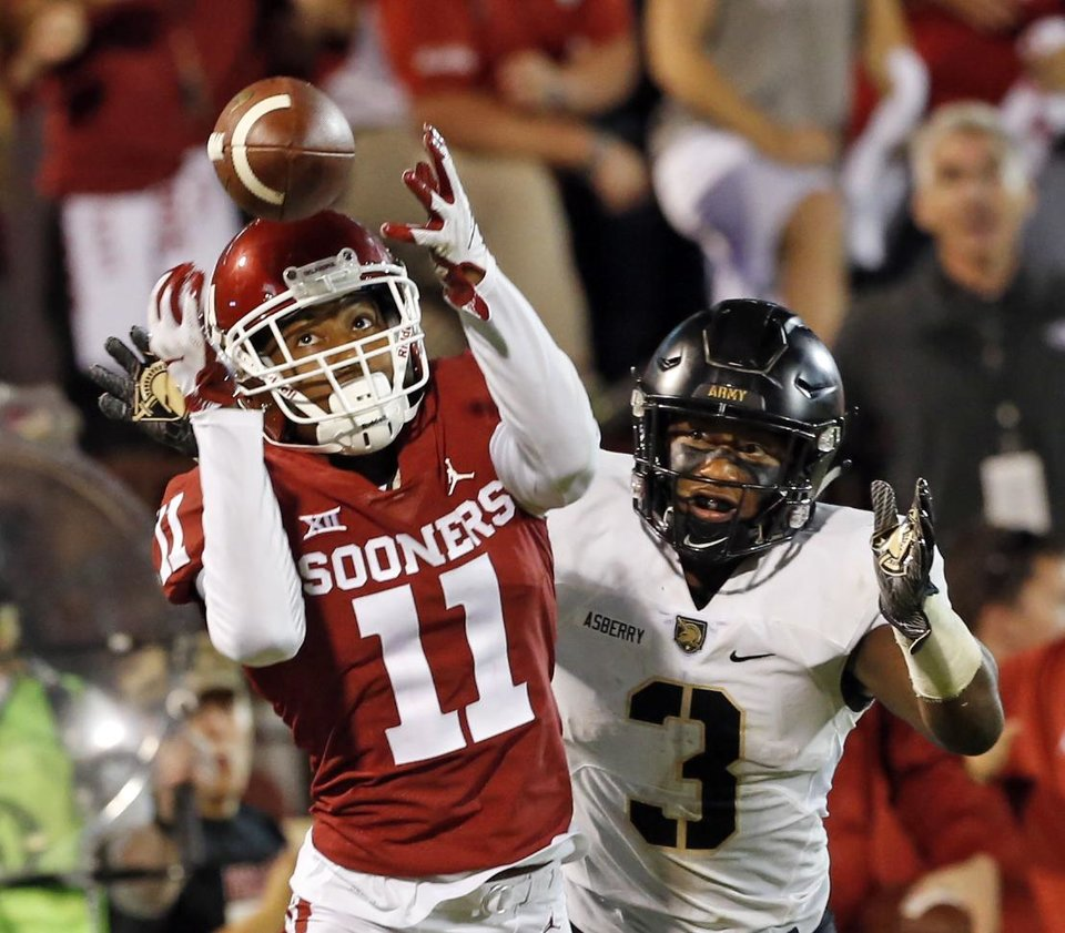 Photo - Oklahoma's Parnell Motley (11) intercepts a pass to end the game during a college football game in which the University of Oklahoma Sooners (OU) defeated the Army Black Knights 28-21 at Gaylord Family-Oklahoma Memorial Stadium in Norman, Okla., on Saturday, Sept. 22, 2018. Photo by Steve Sisney, The Oklahoman