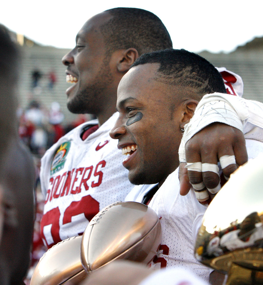Photo - Gerald McCoy, defensive lineman of the game, and Ryan Broyles, player of the game hold a collection of trophys after their 31-27 victory at the Brut Sun Bowl college football game between the University of Oklahoma Sooners (OU) and the Stanford University Cardinal on Thursday, Dec. 31, 2009, in El Paso, Tex.   Photo by Steve Sisney, The Oklahoman