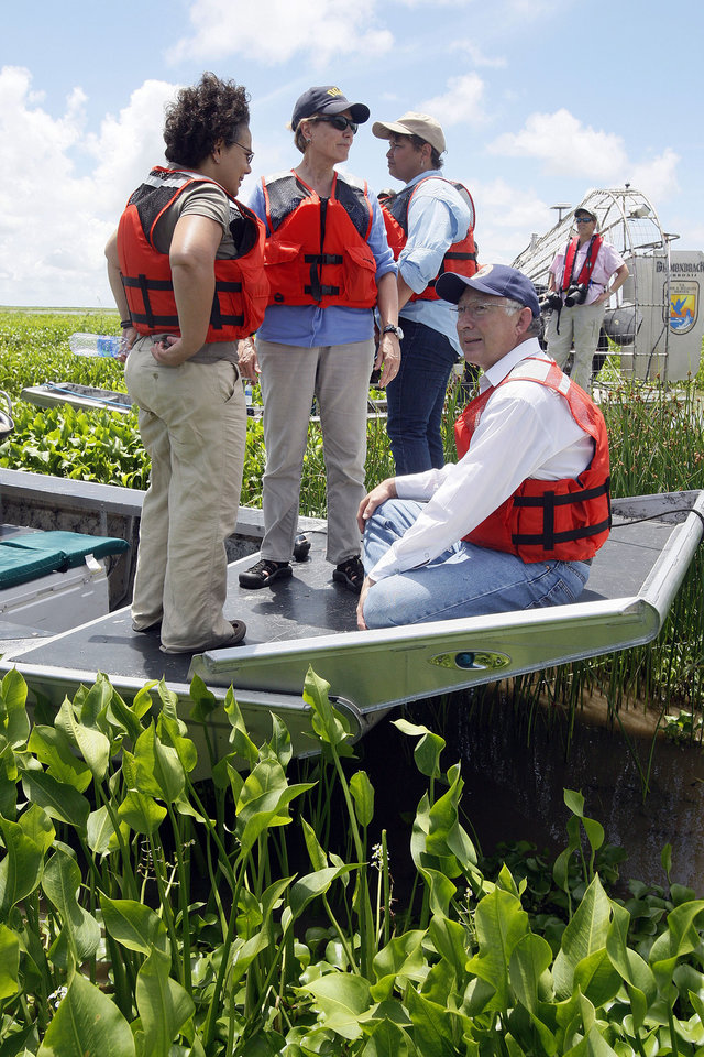 Photo - FILE - In this Thursday, Aug. 19, 2010 file photo, White House Council on Environmental Quality chair Nancy Sutley, left, NOAA Administrator Jane Lubchenco, EPA Administrator Lisa Jackson and Interior Secretary Ken Salazar look out at wetlands from an air boat during a tour of the Delta National Wildlife Refuge on the coast of Louisiana. The tour was held to show areas of opportunity for wetlands restoration and growth along the Louisiana coast after the Deepwater Horizon oil spill. The head of the National Oceanic and Atmospheric Administration said Wednesday, Dec. 12, 2012 she will leave her post at the end of February 2013. (AP Photo/Patrick Semansky)